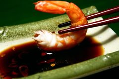 Shrimp. Close up of shrimp dipped in chili and soy sauce royalty free stock photos
