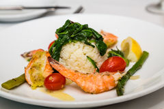 Shrimp Appetizer with Rice and Spinach Stock Images