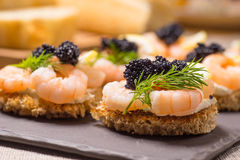 Shrimp Appetizer served on toasted bread. And served on a slate plate stock photography