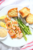 Shrimp and asparagus dinner vertical Stock Photo