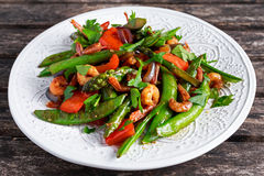 Shrimp and Asparagus stir fry food on white plate Stock Image