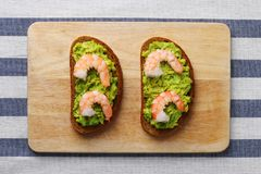 Shrimp and avocado on bread with light background healthy breakfast royalty free stock photo