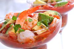 Shrimp with Avocado Salsa Sauce royalty free stock images