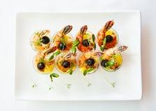 Shrimp, avocado, tomato, salmon cocktail salad served in a glass. Shrimp, avocado, tomato, salmon cocktail salad served in a glass royalty free stock photos