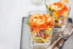 Shrimp, avocado, tomato, salmon and red caviar cocktail salad in Royalty Free Stock Photo
