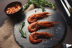 Shrimp with basil on stone. Top view royalty free stock photography