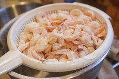 Shrimp. A basket of floured shrimp ready to be battered and deep fried Stock Image