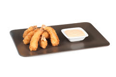 Shrimp at batter. With sauce on a white Stock Photography