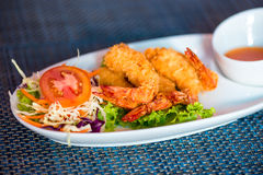 Shrimp in batter with sweet-sour sauce on plate Royalty Free Stock Photos