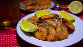 Shrimp with beer. King prawns with beer and lemon, still life Royalty Free Stock Images