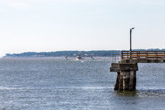 Shrimp Boat Beyond Pier Royalty Free Stock Photo