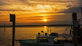 Shrimp boat docked at Jekyll Island wharf at sunse Stock Photography