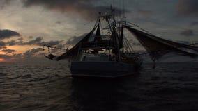 Shrimp boat at morning sun stock video footage
