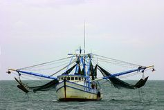 Shrimp boat with nets. A shrimp boat looking for shrimp in Atlantic Ocean Stock Images