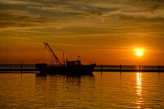 Shrimp Boat in Silhouette at Sunrise Royalty Free Stock Images