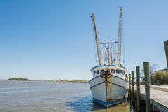 Shrimp boat tied to pier Stock Photography