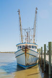 Shrimp boat tied to pier Royalty Free Stock Images