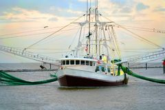 Louisiana Shrimp Boat. A shrimp boat used in commercial fishing on a bayou in South Louisiana stock photos