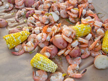 Shrimp Boil. Shrimp, corn on the cob and redskin potatoes on brown paper Stock Image