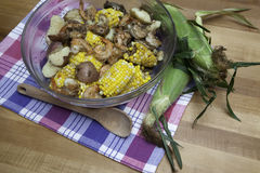 Shrimp Boil 2. A glass bowl is filled with corn on the cob, red potatoes, and shrimp - a classic shrimp boil. Everything is seasoned to perfection and steaming stock photo