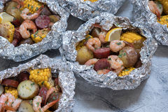 Shrimp Boil with Sausage Potato and Corn foil pack. Homemade Traditional Cajun Shrimp Boil with Sausage Potato and Corn foil pack Royalty Free Stock Photos