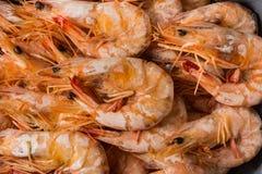 Shrimp boil on wooden table. Shrimp boil on wooden table food background stock images