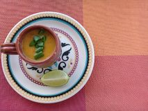 Shrimp broth with lemon on the plate stock photo