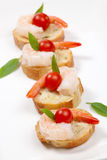 Shrimp Canape. Closeup of delicious Shrimp Canape with cherry tomatoes, basil and wasabi spread stock photos