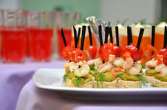 Shrimp canapes with tomato. And dill on white plate closeup. Small shallow DOF Stock Image