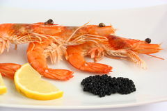 Shrimp, caviar and lemon Stock Photo