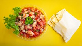 Shrimp Ceviche with crackers and jalapeños royalty free stock photo