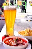 Shrimp ceviche with popcorn and beer. royalty free stock photos