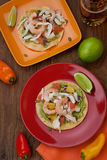 Shrimp Ceviche Tostada. Two plates of shrimp ceviche tostadas with fennel and grapefruit, beer, garnished with mini bell pepper Royalty Free Stock Photo