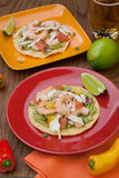 Shrimp Ceviche Tostada. Two plates of shrimp ceviche tostadas with fennel and grapefruit, beer, garnished with mini bell pepper Stock Photo