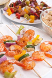 Shrimp, chicken and vegetables kebabs Royalty Free Stock Images