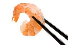 Shrimp and Chopsticks. Streamed shrimp held with black inlaid chopsticks Stock Photography