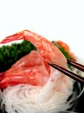 Shrimp in chopsticks Royalty Free Stock Image
