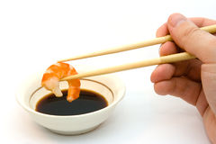 Shrimp in chopsticks. And soy sauce Royalty Free Stock Image