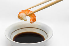 Shrimp in chopsticks. And soy sauce Royalty Free Stock Photography