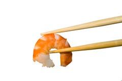 Shrimp in chopsticks. Close-up Stock Images
