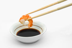 Shrimp in chopsticks. And soy sauce Stock Photos