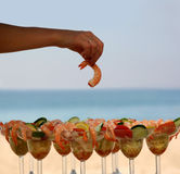 Shrimp cocktail. Woman is having shrimp cocktail on the beach Stock Photography