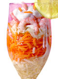 Shrimp cocktail isolated. Shrimp salad with vegetables and friuts in the glass bocal Stock Image