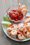 Shrimp Cocktail with sauce and lime wedges Stock Images
