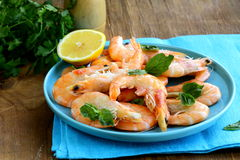 Shrimp cooked with lemon and basil Stock Photo