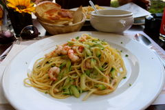 Shrimp and courgette pasta dish in italy. At a restaurant Stock Photos