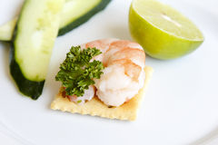Shrimp on a cracker stock image