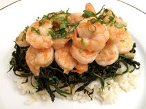 Shrimp Dinner With Spinach and Rice Stock Photos