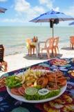 Shrimp dish served at a beach bar on Coroa do Aviao islet, popular destination on the north coast of Pernambuco state. Igarassu, Brazil stock photo