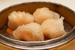 Shrimp Dumplings. Shrimp Dumpling is a type of popular Chinese Dim Sum dish (Type of Chinese food). The Shrimp fillings are wrapped with Glutinous rice wrapper Stock Photo